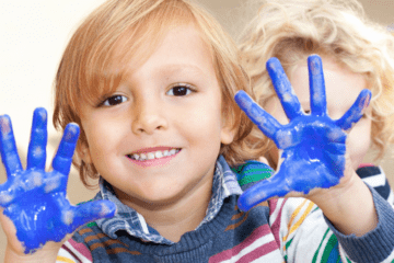 boy with blue paint on his hands