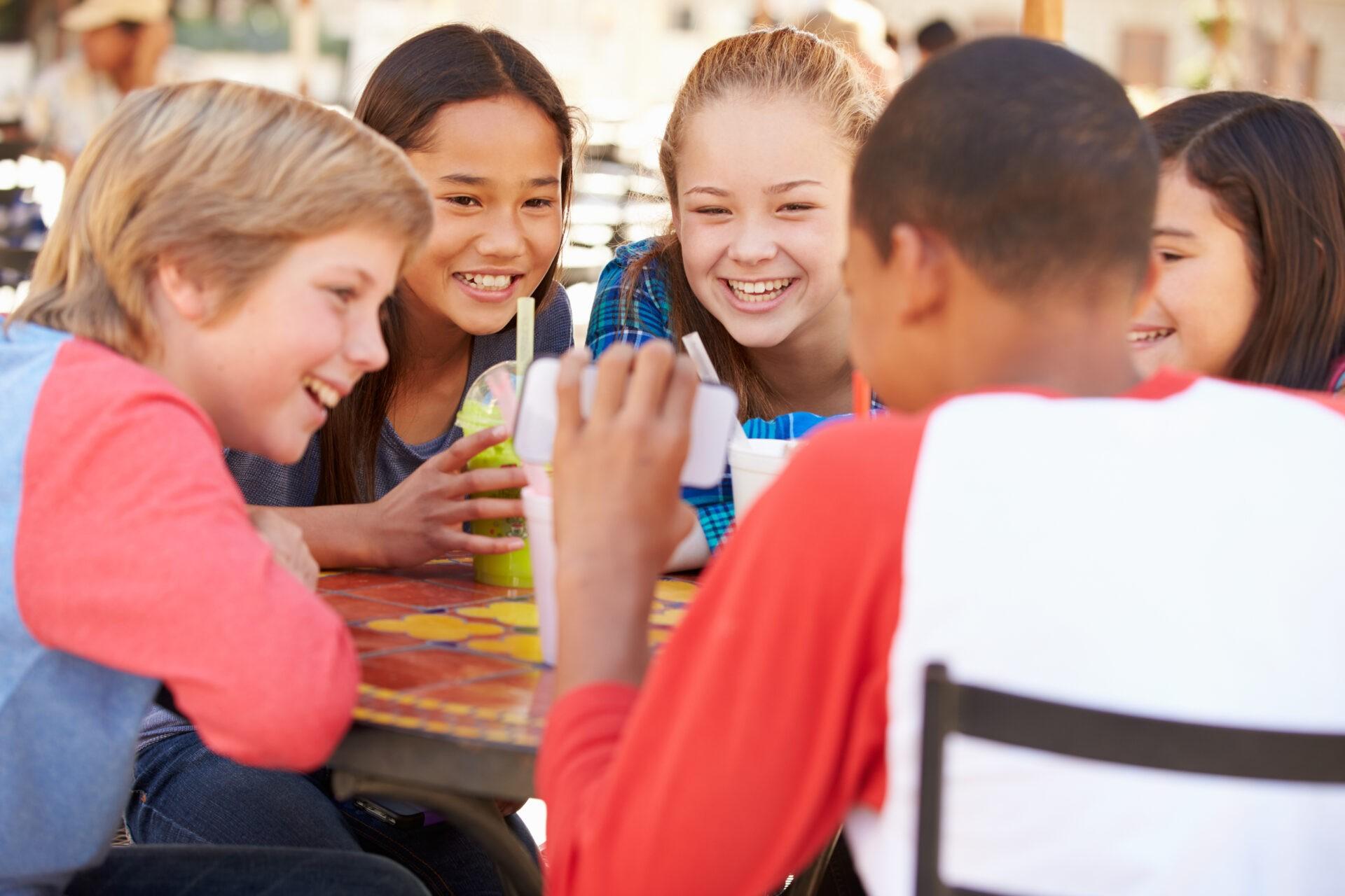 children having lunch laughing