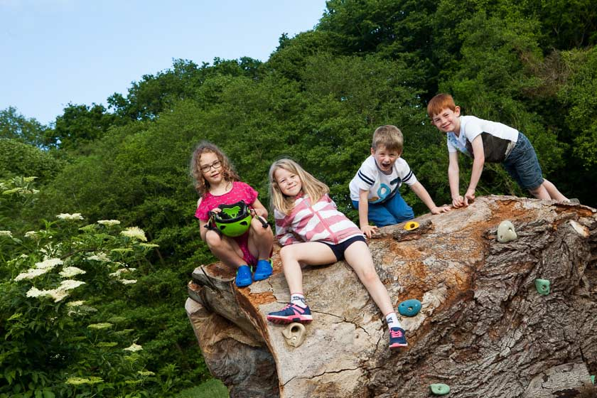 Children sitting on a log