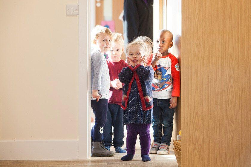 Children standing in a doorway