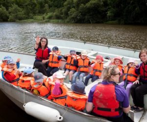 Fairthorne Manor staff and children in boats