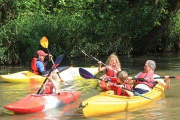 Families kayaking