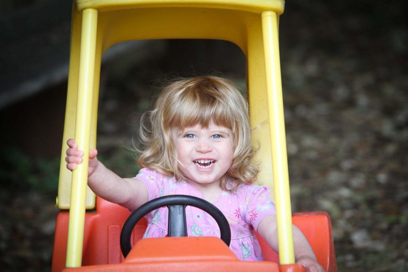 Outdoor play in a car at Shanklin Nursery