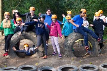 Group happy doing team challenge